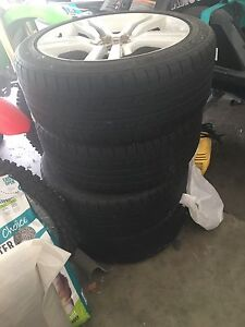 4x Genuine EV ss rims and tires Goodna Ipswich City Preview
