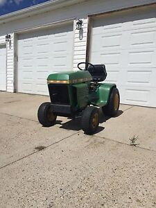 216 John Deere  garden tractor with mower