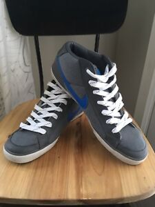 Men's Size 13 Grey Nike Shoes With Blue Swoosh