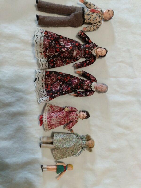Vintage dollhouse dolls, cloth plastic fabric bendable handmade?