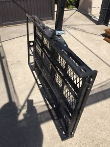 Trailer hitch cargo carrier with ramp.