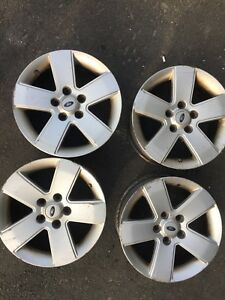 "Ford Fusion 16"" factory rims."