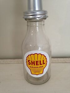 Antique glass oil bottle imperial quart, tin can gas pump sign