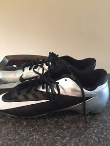 Nike cleats.   Warn once too small size 13.5