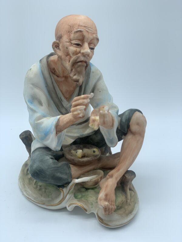 NapcoWare Porcelain Figurine Asian Man G4923