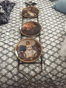 Norman Rockwell Plates and rack.