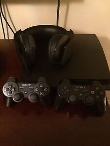 PS3 for sale with two controllers and game headset and Fifa 15