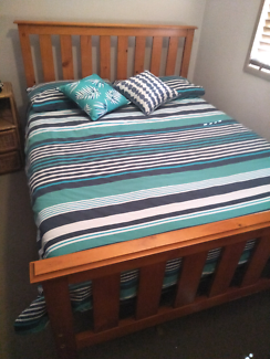 Wood slat double bed with near new matress.