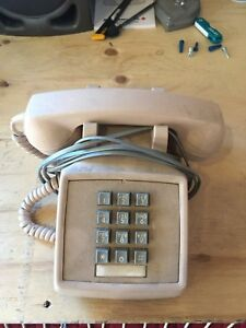 Older push button phone.  Works.