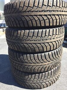 Barely used 225/55/18 studded snow tires