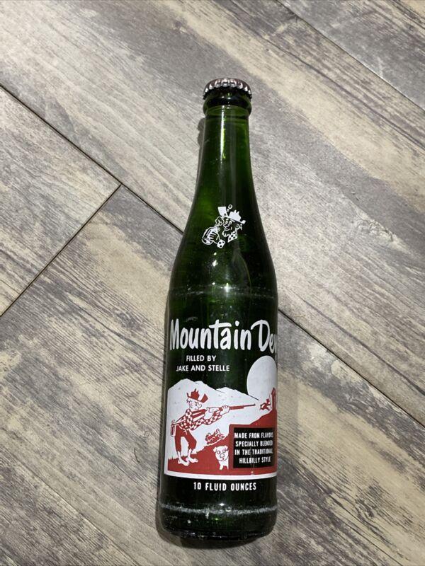 "MOUNTAIN DEW HILLBILLY GLASS SODA BOTTLE ""FILLED BY JAKE AND STELLE"" FULL SEALED"