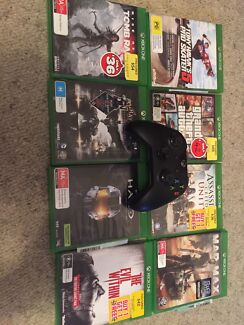 Xbox one with controller, charger & 8 games