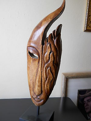 HAND CARVED WOODEN MASK SCULPTURE W/ WOODEN BASE FROM BALI