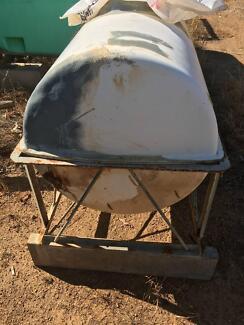 fiberglass tank mounted on a frame [around 150 litres ? no marks]
