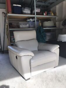 Arm chair with built in foot rest