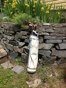 Set of golf clubs, bag and balls.
