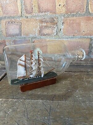 Vintage Ship Boat In A Glass Bottle With Wooden Plinth