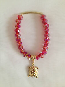 RED IRIDESCENT FACETED BEADS STRETCH BEADED BRACELET GOLD TURTLE CHARM 6 INCH
