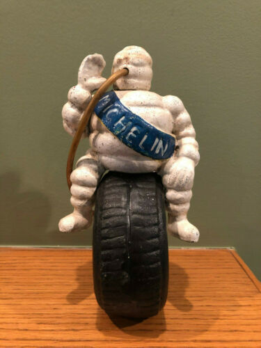 Heavy Cast Iron MICHELIN MAN Bibendum Sitting on Tire Advertising Piece