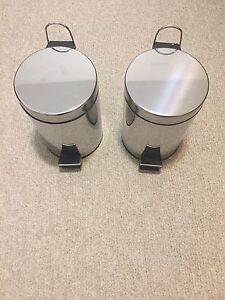 2 stainless steel garbage cans