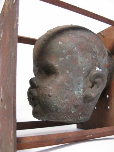 VINTAGE INDUSTRIAL CAST METAL TOY BABY DOLL HEAD MOLD STEAMPUNK CREEPY ORWELLIAN