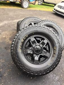 Four Rockstar rims with tires.  Tires Ginell GN1000 35x12.5 17