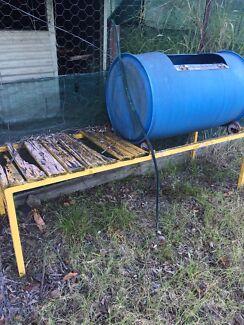 Chook feed drum on steel frame