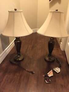 A set of Ashley Furniture Lamps