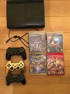 PS3 with 3 controllers + 4 games
