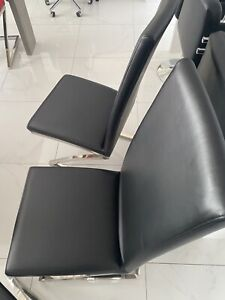 6 black leather dining chairs with chrome base in very good condition
