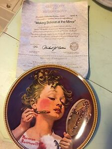 Norman Rockwell plates with hanging rack (2)
