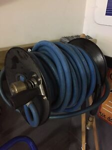 Pressure washer steamer hose and  wall mount spool