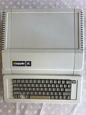 Apple IIe with 128KB, 5.25 Disk Drive, Controller Card, Software and Manuals