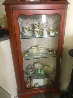 Glass fronted lockable antique cabinet
