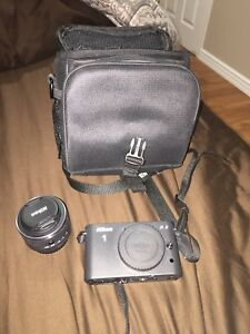 Nikon J1 camera with accessories