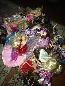Bin of dolls