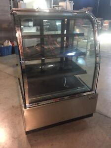 Stainless curved glass bakery display case