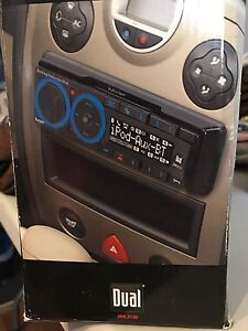 AM/FM car stereo with in-dash docking station for iPod
