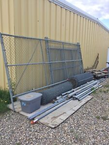 Chain link fence, poles, and gates