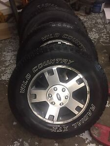 """18"""" Ford rims and tires"""