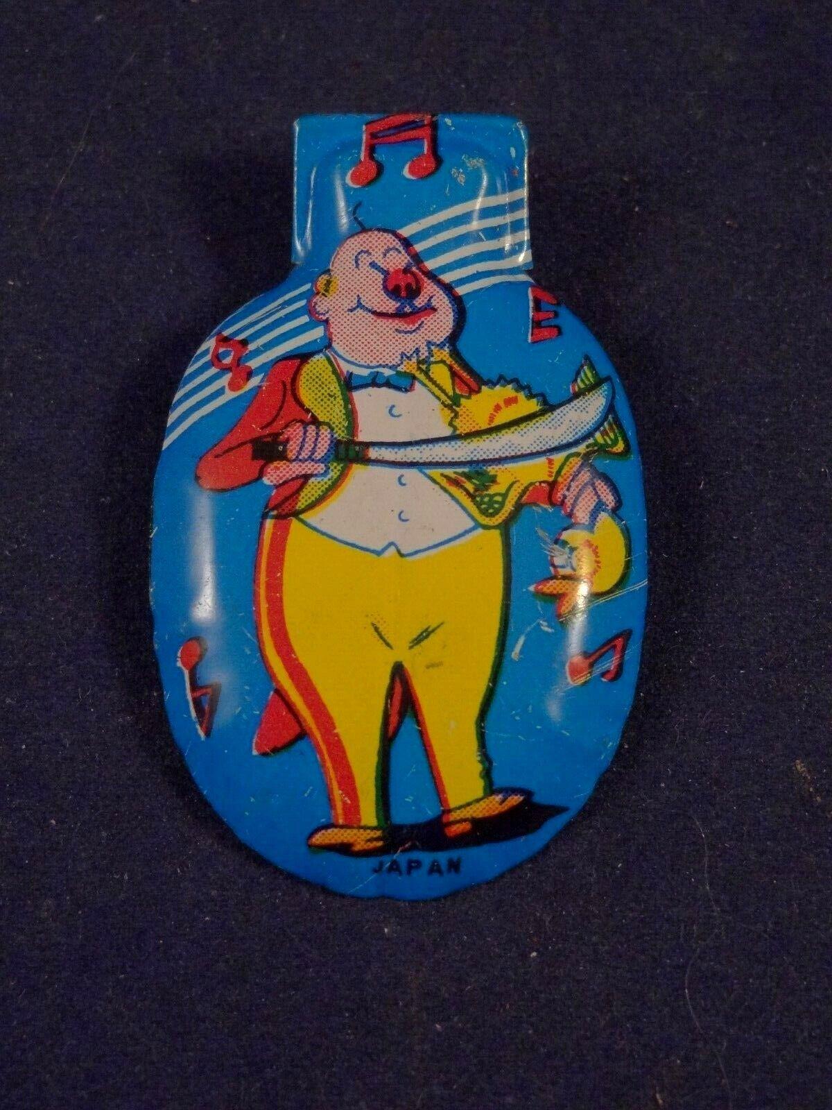 Ancien jouet musical tôle clic-clac cri-cri clown jouant du canard années 60