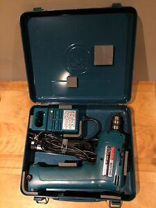 Makita 9.6 V cordless drill with charger and case