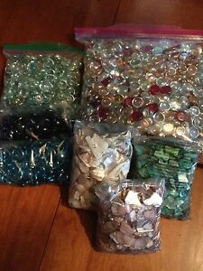 Lot of decorative jewel stones and colored sea shells