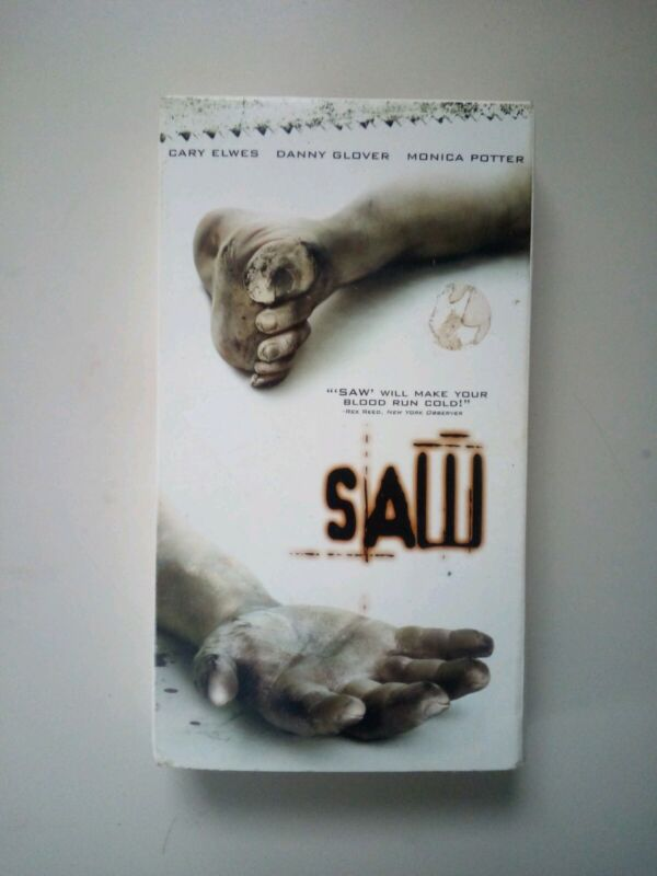 Saw - VHS - Horror Cary Elwes Danny Glover Tobin Bell Twisted Pictures Rated R