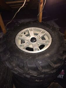 Canam rims and tires stock off 2008 outlander