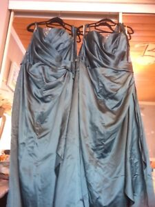 Two teal coloured brides maid dresses