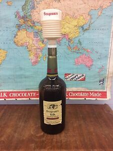 Seagrams V.O. Whiskey. Empty bottle with pump. Vintage. 1967.