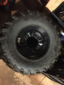 Polaris rim and tire new