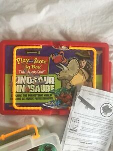 Dinosaurs in a box. Dinosaur puzzle. Still in bags.