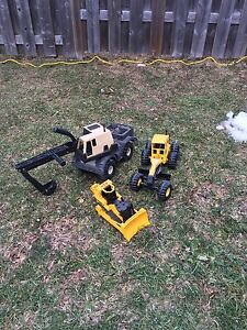2 Metal Tonka Trucks, other has batteries